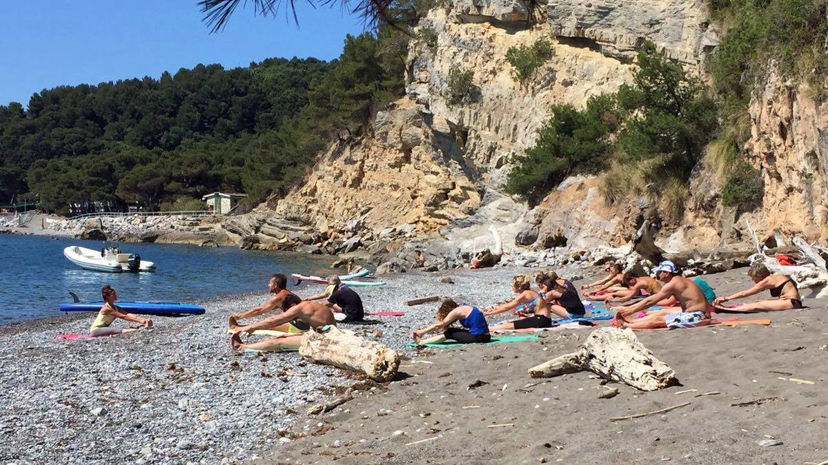 Yoga al mare con Kau Kau Club